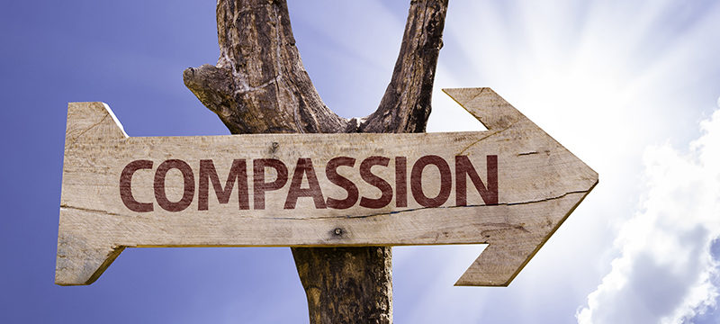 Compassion sign post